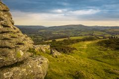 A panoramic view of Dartmoor National Park from Watern Tor, the green landscape leads into the distance