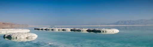 Panoramic view of dead sea salt on beach at sunrise. Israel royalty free stock photos