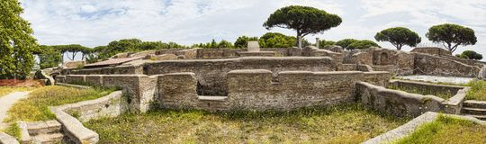 Panoramic view in 180 degrees of the Roman empire ruin and lush vegetation  at archaeological excavations in Ostia Antica - Rome. Panoramic view in 180 degrees stock photo