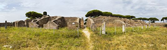 Panoramic view in 180 degrees in the Roman empire village ruins in Ostia Antica with the gym of Neptune spa at archaeological. Excavation - Rome royalty free stock photo