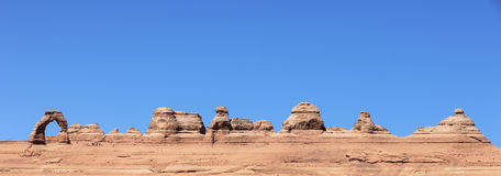 Panoramic view of Delicate Arch abd cliff Royalty Free Stock Images