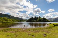 Derwnt Water Lake with swimming dog, Keswick, Cumbria, UK. Panoramic view of Derwnt Water Lake with swimming dog, Keswick, Cumbria, UK Royalty Free Stock Photos