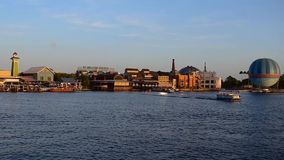 Panoramic view of Disney Springs , air balloon and taxi boats sailing on sunset background