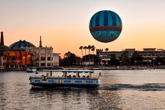 Panoramic view of Disney Springs and water taxi on colorful sunset background at Lake Buena Vista area 1 stock image