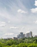 Panoramic view of the Dnieper center. High building on a hill immersed in the greenery. Stock Photo