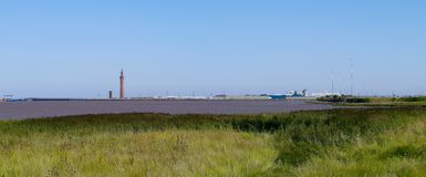 Panoramic view of dock area by estuary Royalty Free Stock Photos