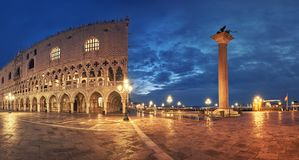 Panoramia of Doge`s Palace and St. Marco`s square at night in Ve. Panoramic view of Doge`s Palace, or Doge Palace, and St. Marco`s square a rainy night in Venice stock photos