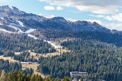 Panoramic view of the Dolomites Alps Mountains in Italy with ski slopes in spring. Panoramic view of the Dolomites Alps Mountains near Trento in Italy with ski Royalty Free Stock Photo