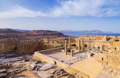 Panoramic view of Doris Temple of Athena Lindia, medieval castle on Acropolis of Lindos with blue bay beneath, Rhodes Stock Photo