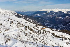 Panoramic view down an alpine mountain valley Royalty Free Stock Image