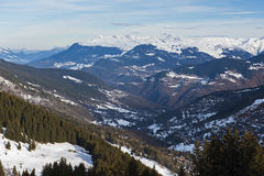Panoramic view down an alpine mountain valley Stock Photos