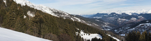 Panoramic view down an alpine mountain valley Royalty Free Stock Photos