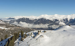 Panoramic view down an alpine mountain valley Stock Images
