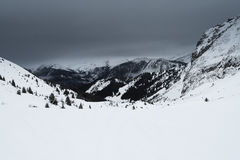 Panoramic view down a mountain valley with overcast sky Stock Image