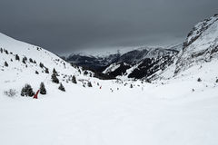 Panoramic view down a mountain valley with overcast sky Stock Images