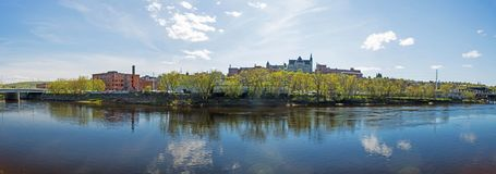 Sherbrooke, Quebec Downtown Panorama Photo. Panoramic view of downtown Sherbrooke, Quebec, Canada across the Saint Francois River in the Eastern Townships Region stock images