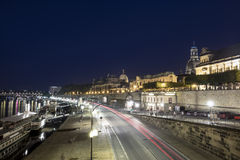 Panoramic view of Dresden in night and the river Elbe. Royalty Free Stock Images