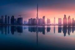Panoramic view of Dubai Business bay, UAE. Mystical panoramic view of Dubai Business bay with purple sunrise, UAE Royalty Free Stock Photos