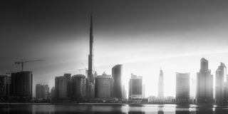 Panoramic view of Dubai Business bay, UAE. Mystical panoramic view of Dubai Business bay with purple sunrise, UAE . Black and white concept Stock Images