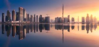 Panoramic view of Dubai Business bay, UAE. Mystical panoramic view of Dubai Business bay with purple sunrise, UAE Stock Image