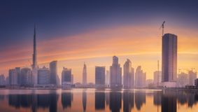 Panoramic view of Dubai Business bay, UAE. Mystical panoramic view of Dubai Business bay with purple sunrise, UAE royalty free stock image
