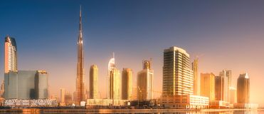 Panoramic view of Dubai Business bay, UAE. Panoramic view of Dubai Business bay with golden reflection of sun on skyscrapers during sunrise, UAE Stock Image