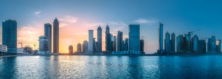 Panoramic view of Dubai Business bay, UAE. Vibrant panoramic view of Dubai Business bay at evening light, UAE Royalty Free Stock Photo