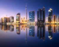 Panoramic view of Dubai Business bay, UAE. Vibrant panoramic view of Dubai Business bay during evening with reflection on water, UAE Stock Photo
