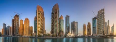 Panoramic view of Dubai Marina bay, UAE. Panoramic view of Dubai Marina bay with reflection of skyscrapers on water during sunrise, UAE Royalty Free Stock Photography