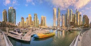 Panoramic view of Dubai Marina bay with yacht and cloudy sky, Dubai, UAE. Royalty Free Stock Images