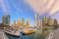 Panoramic view of Dubai Marina bay with yacht and cloudy sky, Dubai, UAE stock photography