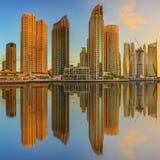 Panoramic view of Dubai Marina bay with yacht and cloudy sky, Dubai, UAE stock photo