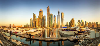 Panoramic view of Dubai Marina bay with yacht and cloudy sky, Dubai, UAE. Royalty Free Stock Photo