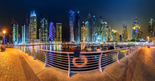 Panoramic view of Dubai Marina bay with yacht and cloudy sky, Dubai, UAE Royalty Free Stock Images