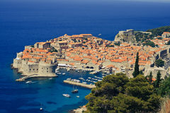 Panoramic view of Dubrovnik city with blue water Royalty Free Stock Photo