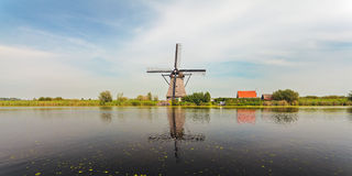 Panoramic view of a Dutch windmill at Kinderdijk Stock Photos