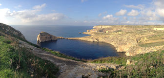 Panoramic view of Dwejra and Fungus rock, Gozo, Maltese islands. Seaside landscape in Dwejra, Gozo, a popular travel and hiking destination Royalty Free Stock Images