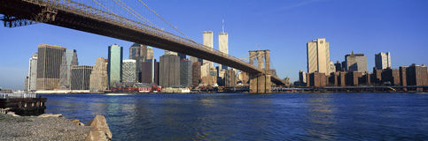 Panoramic view of East River and Brooklyn Bridge going to lower Manhattan, New York City, New York with World Trade Center Royalty Free Stock Photos