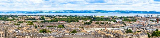 Panoramic view of Edinburgh cityscape and sea shoreline in Scot. Edinburgh, Scotland - August 25, 2018: Panoramic view of the city and sea shoreline seen from royalty free stock photo