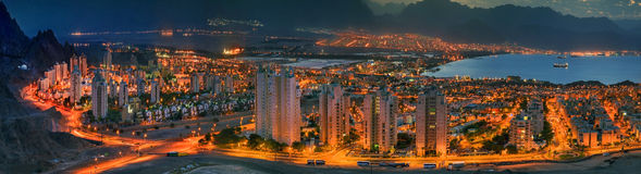 Panoramic view on Eilat (Israel) and Aqaba (Jordan). The image was taken from the hills surrounding Eilat city early in the morning Royalty Free Stock Photography