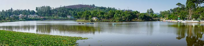 Panoramic view of Emerald Lake, Yercaud. A panoramic view of Yercaud lake. Houses of Yercaud town and public garden are to the extreme left while the boat house Stock Photo