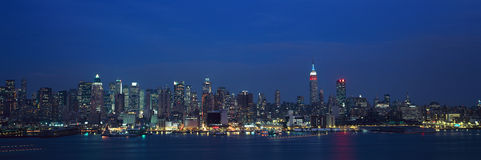 Panoramic view of Empire State Building and Manhattan, NY skyline with Hudson River and harbor, shot from Weehawken, NJ Royalty Free Stock Images