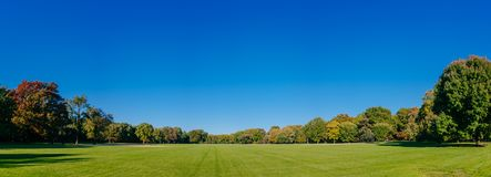 Panorama of empty Great Lawn of Central Park under clear blue sky, in Manhattan, New York City, USA royalty free stock images