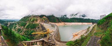 Panoramic view of The Enguri hydroelectric power station HES. The Jvari Reservoir next to Inguri Dam, surrounded by mountains, Upp. Er Svaneti, Georgia. Second Stock Image