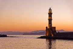 Panoramic view of the entrance to Chania harbor with lighthouse at sunset, Crete Stock Photography