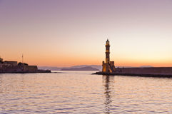 Panoramic view of the entrance to Chania harbor with lighthouse at sunset, Crete Royalty Free Stock Images