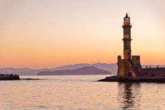 Panoramic view of the entrance to Chania harbor with lighthouse at sunset, Crete Stock Images