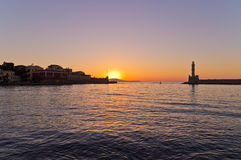 Panoramic view of the entrance to Chania harbor with lighthouse at sunset, Crete Stock Photos