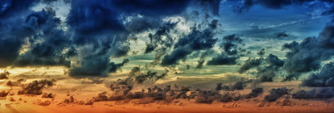 Panoramic view of evening dramatic sky at sunset Royalty Free Stock Image