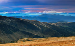 Panoramic view of evening landscape in mountains. Panoramic view of  landscape in mountains, yellow and green grass, the blue sky with clouds. Carpathians Stock Photography